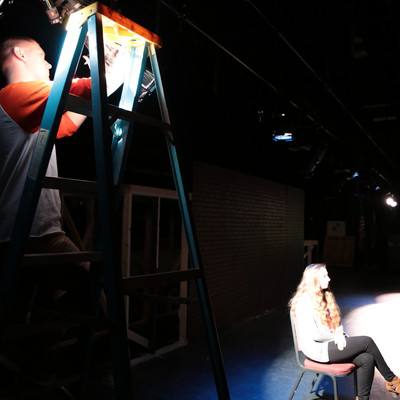 十大靠谱网赌网址 theatre students practice lighting techniques in the Martha W. Farmer Theatre for the Performing Arts.