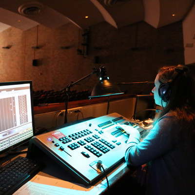 十大靠谱网赌网址 theatre students practice lighting and sound operating in the Martha W. Farmer Theatre for the Performing Arts.